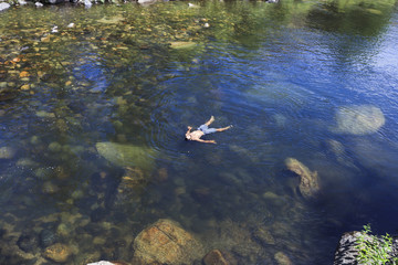 High angle view of man floating on water