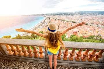 Young female traveler enjoying great view on the Nice city in France Wall mural