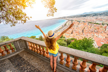 Ingelijste posters Nice Young female traveler enjoying great view on the Nice city in France