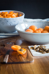 Halfs of apricots on cutting board. Selective focus.
