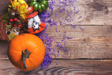 Happy Halloween postcard. Pumpkins and decor against an old wood background. Purple and vintage tinted