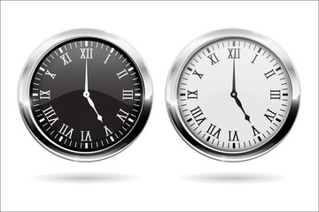 Clock. Black and white clock face with roman numerals and chrome frame
