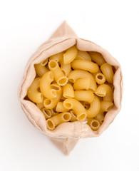 plenty of raw pasta in bag on white background