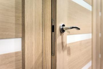 Part of open door with silver door-handle