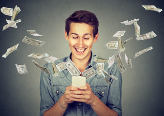 man using smartphone with dollar bills flying away from screen