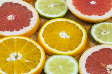 Citrus fruit background with sliced f oranges lemons lime tanger