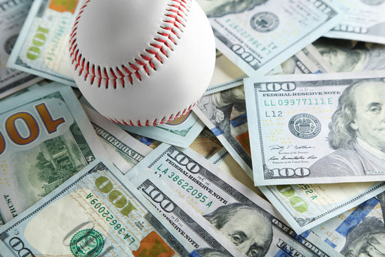 Baseball ball on money bills