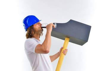 worker with a hammer drinking wine