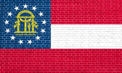 Flag of Georgia state brick wall texture backdrop