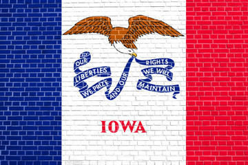 Flag of Iowa on brick wall texture background