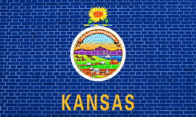 Flag of Kansas on brick wall texture background