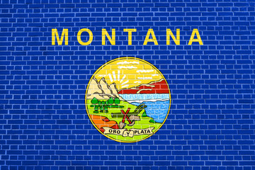 Flag of Montana on brick wall texture background