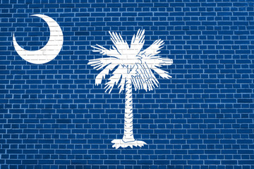 Flag of South Carolina brick wall texture backdrop