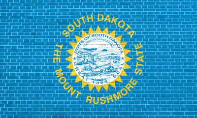 Flag of South Dakota brick wall texture background
