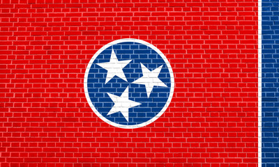 Flag of Tennessee on brick wall texture background