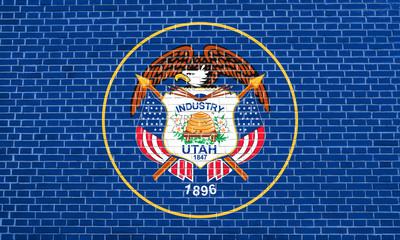 Flag of Utah on brick wall texture background