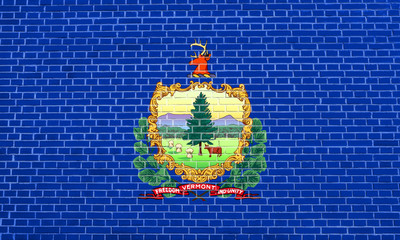 Flag of Vermont on brick wall texture background
