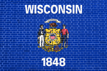 Flag of Wisconsin on brick wall texture background