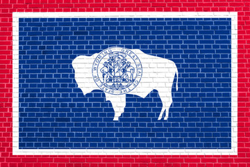 Flag of Wyoming on brick wall texture background