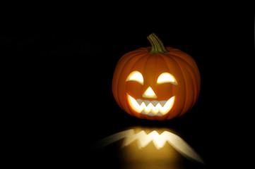 pumpkin lantern for Halloween glowing in dark