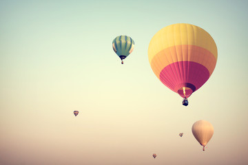 Colorful hot air balloons flying on sky with fog - retro filter effect style