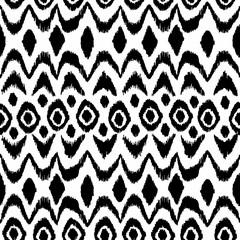 Ikat damask seamless pattern. Black diamonds on a white backgrou