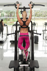 Young Woman Doing Back Exercise In Fitness Center