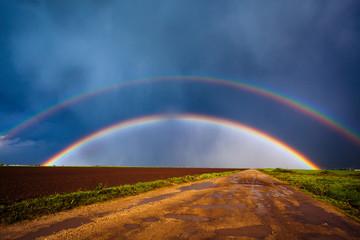Double rainbow over field