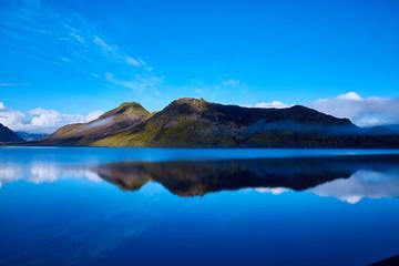 Lake coast with mountain reflection at the sunrise, Iceland