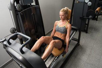 Young Woman Exercise Legs On Press Machine