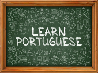 Hand Drawn Learn Portuguese on Green Chalkboard.