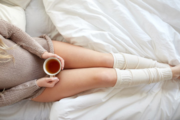 Fototapete - close up of woman with tea cup in bed