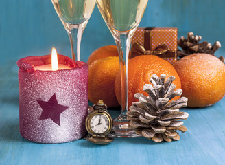 New Year card with watch, candle and pine cone