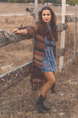 Woman is wearing clothes in bohemian style