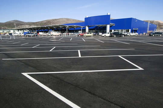 White stripes on the blacktop on parking lot in the shopping mall