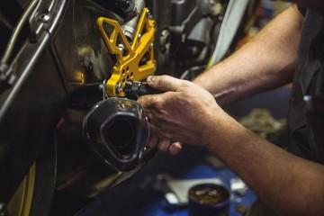Mechanic examining a motorbike