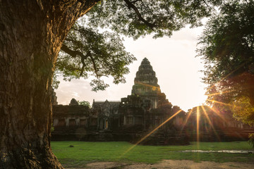 Ancient castle Prasat Hin Phi Mai with lenses flare effect at sunset, Phi Mai district, Nakhon Ratchasima, Thailand