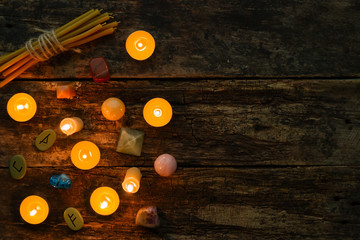objects for divination, runes and candle on a wooden background