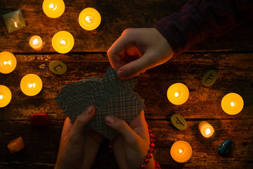 man chooses tarot card on the session at the fortuneteller