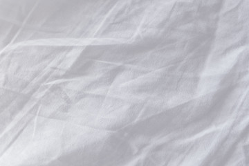 Crumpled bed sheets texture as background