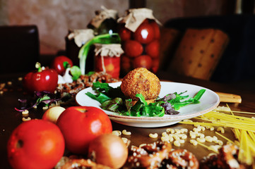 fried meat ball cutlet of veal on a plate on background tree and vegetables closeup.