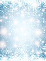 Blue winter background with snowflakes.