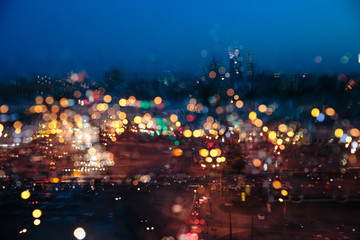 A blurred picture of a night city in the rain Wall mural