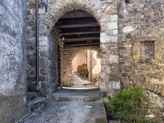 Medieval Italian village- detail vault and flowers.