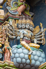 Madurai, India - October 19, 2013: Closeup of Lord Shiva sitting on a berry. He has multiple arms and heads. Facade of West Gopuram at Meenakshi Temple.