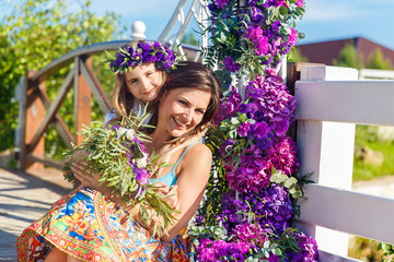 Happy mother and daughter under the arch for the wedding ceremon
