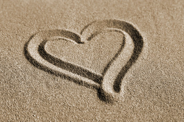 Heart drawn on a sand, valentines day on the beach