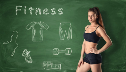 Beautiful young girl standing on the background with fitness sketches.