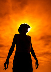 Silhouette of smoker with hot sun faces threat of global warming