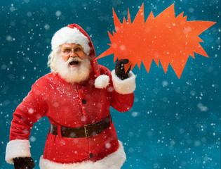 Monstrous Santa Claus showing red sign speech bubble banner, looking unhappy and angry. Santa Claus on blue background. Merry Christmas & New Year's Eve concept.